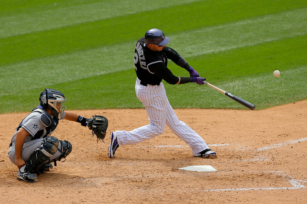 . DENVER, CO - JULY 9:  Troy Tulowitzki #2 of the Colorado Rockies hits his second home run of the game during the eighth inning against the San Diego Padres at Coors Field on July 9, 2014 in Denver, Colorado. (Photo by Justin Edmonds/Getty Images)
