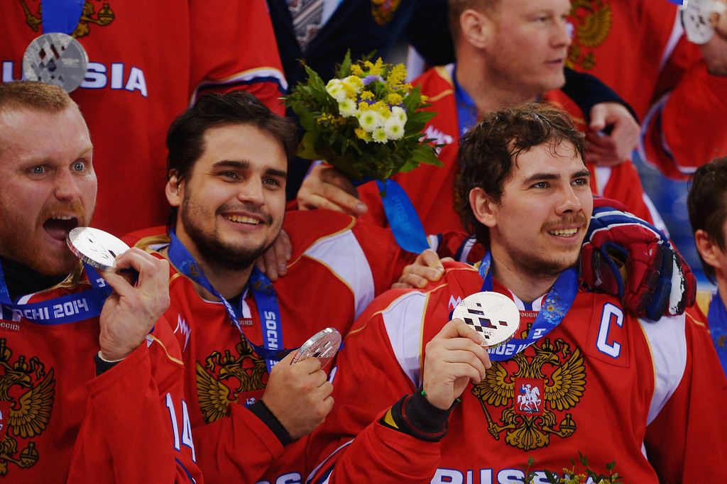. Dmitrii Lisov (R) of Russia holds his silver medal with team mates after the Ice Sledge Hockey Gold Medal game between the United States and Russia on day eight of the Sochi 2014 Paralympic Winter Games at Shayba Arena on March 15, 2014 in Sochi, Russia.  (Photo by Dennis Grombkowski/Getty Images)
