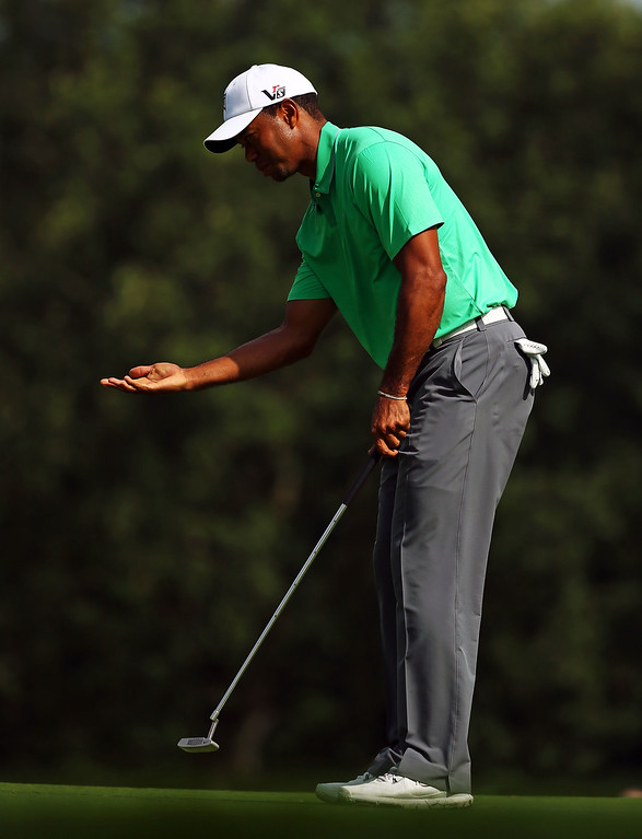 . ROCHESTER, NY - AUGUST 09:  Tiger Woods of the United States reacts to his missed putt on the ninth hole during the second round of the 95th PGA Championship on August 9, 2013 in Rochester, New York.  (Photo by Streeter Lecka/Getty Images)