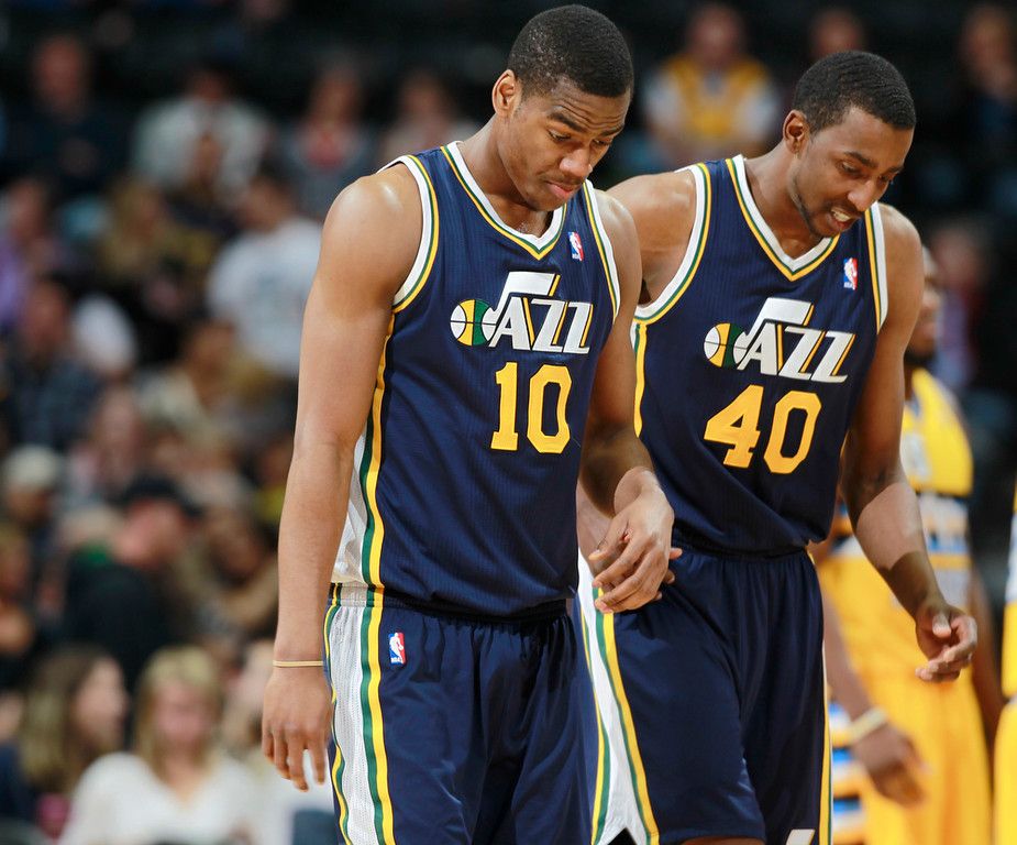 . Utah Jazz guard Alec Burks, front, and forward Jeremy Evans head off the court after the Denver Nuggets\' 101-94 victory over the Jazz in an NBA basketball game in Denver on Saturday, April 12, 2014. (AP Photo/David Zalubowski)