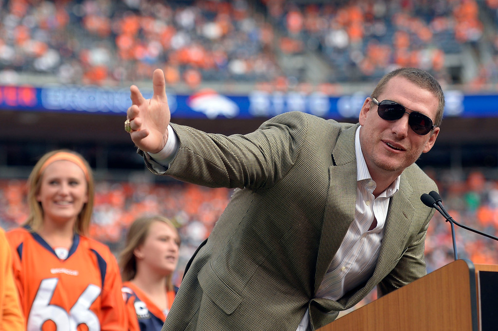 . Former Denver Broncos  Tom Nalen addresses the crowd during the ring of fame ceremony at halftime of the Denver Broncos Philadelphia Eagles game September 29, 2013 at Sports Authority at Mile High. (Photo by John Leyba/The Denver Post)
