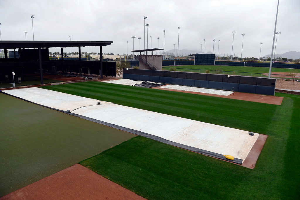 . SCOTTSDALE, AZ. - FEBRUARY 20: With the fields covered up, the Colorado Rockies had a short day hitting in the batting cages due to rain during Spring Training  February 20, 2013 in Scottsdale. (Photo By John Leyba/The Denver Post)