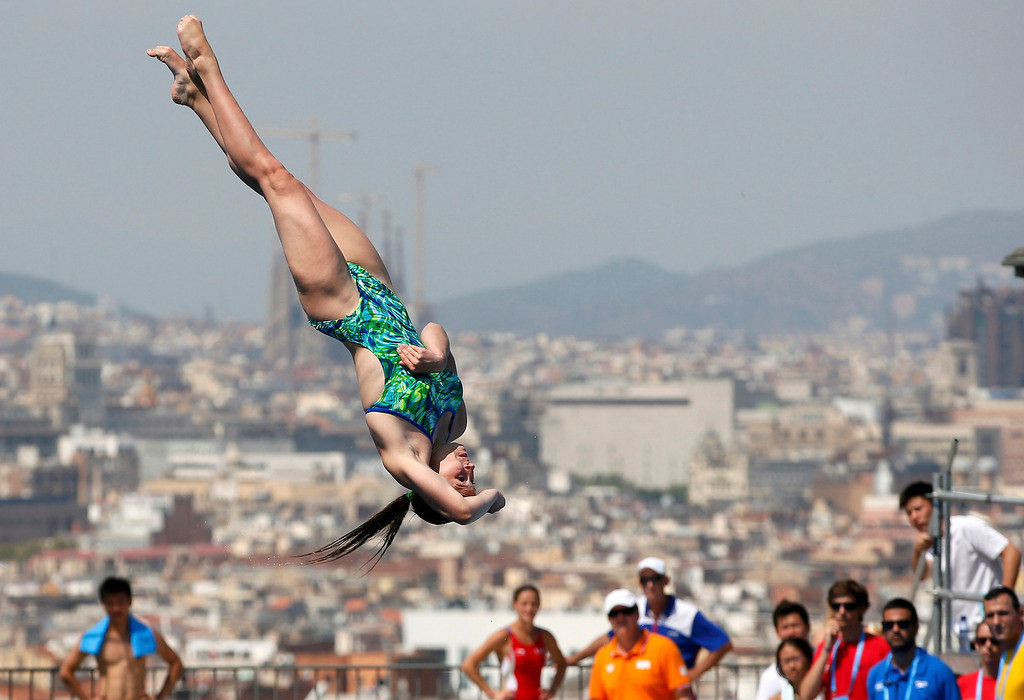 . Russia\'s Daria Govor performs a dive at the women\'s 1m springboard preliminary during the World Swimming Championships at the Montjuic municipal pool in Barcelona July 21, 2013. REUTERS/Gustau Nacarino