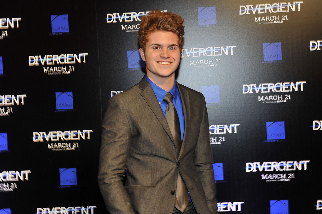 ". Actor Jake Austin Walker attends the ""Divergent\"" screening at Regal Atlantic Station on March 3, 2014 in Atlanta, Georgia. (Photo by Moses Robinson/Getty Images)"