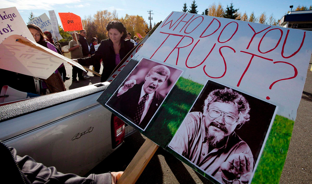. Demonstrators unload signs from a truck outside the Joint Review Panel looking into the Northern Gateway Pipeline in Prince George, B.C. on Oct. 9, 2012.    (AP Photo/The Canadian Press, Jonathan Hayward)