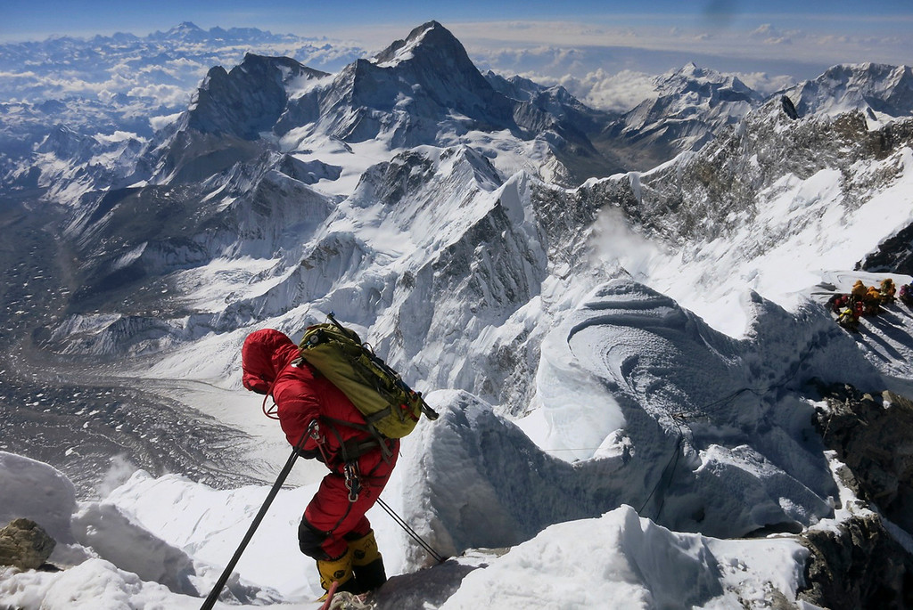 . A climber prepares to descend the Hillary Step as he makes his way down from the summit of Mount Everest, in the Khumbu region of the Nepal Himalayas on May 18, 2013. Nepal celebrated the 60th anniversary of the conquest of Mount Everest on Wednesday, May 29, 2013, by honoring climbers who followed in the footsteps of Edmund Hillary and Tenzing Norgay. (AP Photo/Alpenglow Expeditions, Adrian Ballinger)