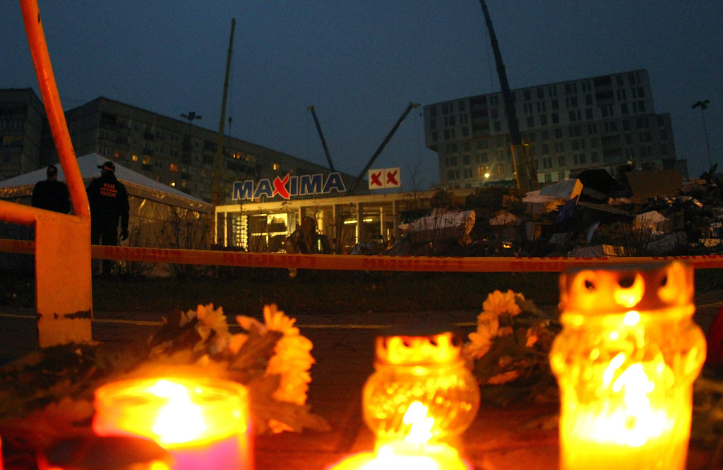. Candles were lit in front of the collapsed shopping centre in Riga on November 22, 2013.   AFP PHOTO / PETRAS MALUKAS/AFP/Getty Images