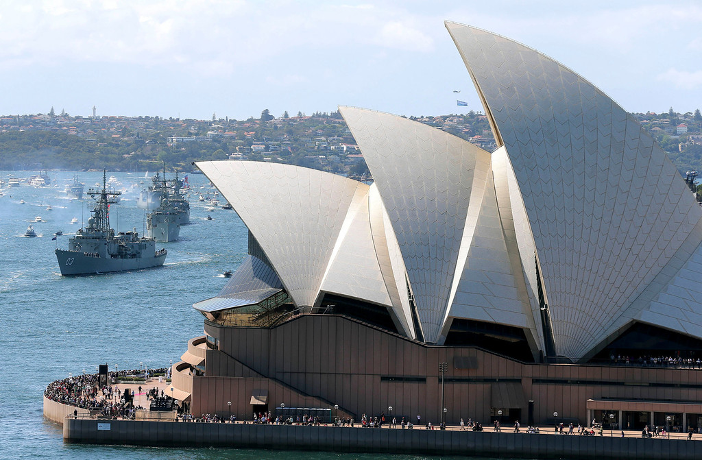 . Australian warships from front, HMAS Sydney, Darwin and Perth sail towards the Opera House as they enter the harbour in Sydney, Australia,  Friday, Oct. 4, 2013 during the International Fleet review.  The Fleet Review is a commemorative event celebrating the centenary of the first entry of the Royal Australian Navy\'s fleet into Sydney Harbour on Oct. 4, 1913. (AP Photo/Rob Griffith)