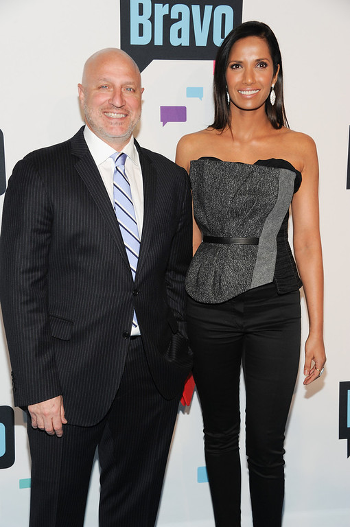 ". Tom Colicchio and Padma Lakshmi from ""Top Chef\"" attend the Bravo Network 2013 Upfront on Wednesday April 3, 2013 in New York. (Photo by Evan Agostini/Invision/AP)"