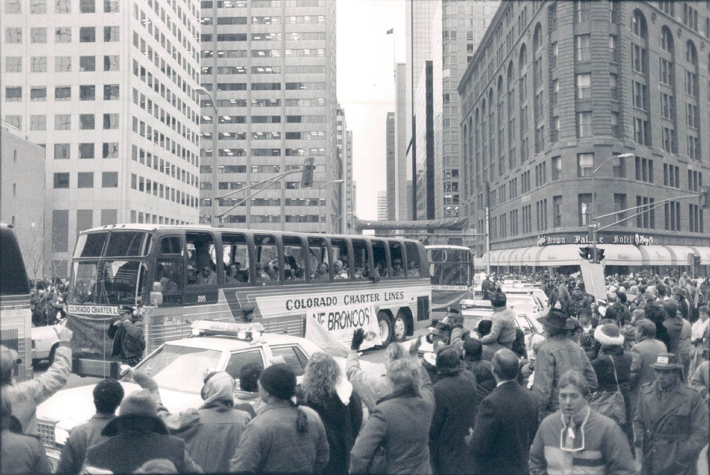 . FEB 2 1988 - Broncos parade turns the corner at 17th St. and Broadway on the way to Civic Center rally. (Jerry Cleveland/The Denver Post)