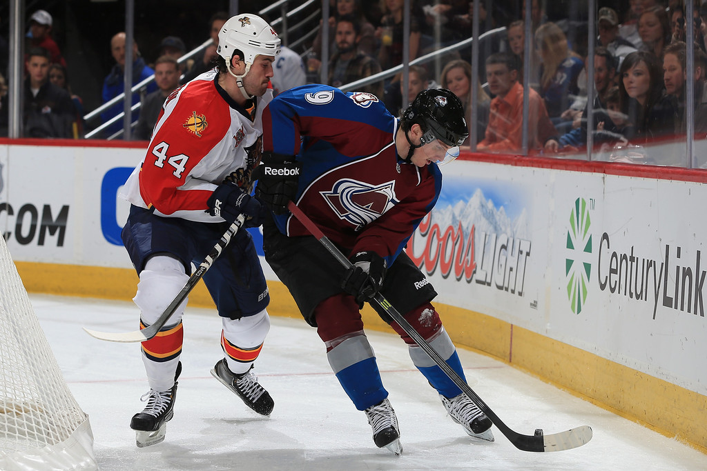 . DENVER, CO - NOVEMBER 16:  Matt Duchene #9 of the Colorado Avalanche controls the puck against Erik Gudbranson #44 of the Florida Panthers at Pepsi Center on November 16, 2013 in Denver, Colorado.  (Photo by Doug Pensinger/Getty Images)