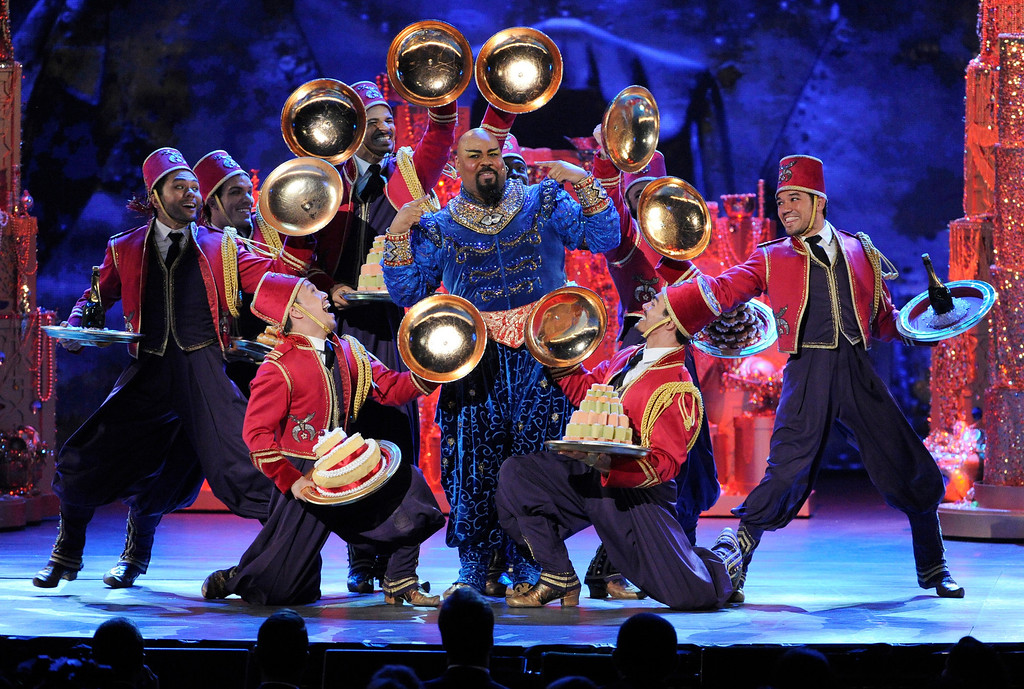 ". James Monroe Iglehart, center, and the cast of ""Aladdin\"" perform on stage at the 68th annual Tony Awards at Radio City Music Hall on Sunday, June 8, 2014, in New York. (Photo by Evan Agostini/Invision/AP)"