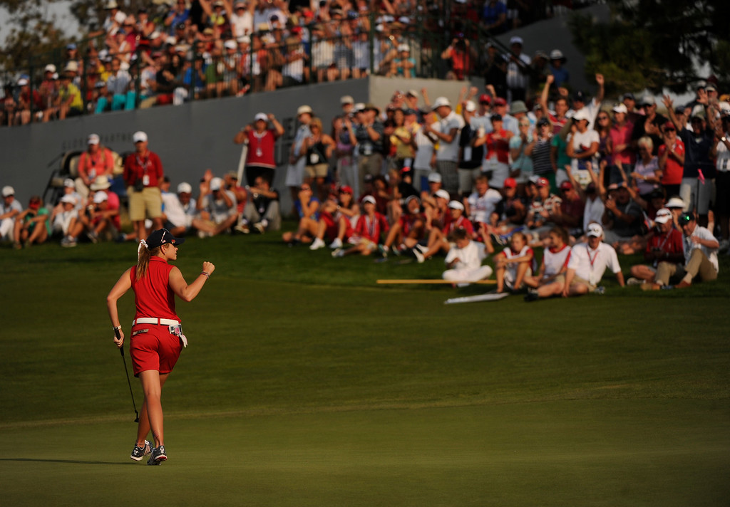. PARKER, CO. - AUGUST 17: American golfer Paula Creamer sunk a putt on the 16th hole to the delight of the gallery Saturday at the Solheim Cup. It was the American Team versus the Europeans as play continued at the Colorado Golf Club Saturday afternoon, August 17, 2013. Photo By Karl Gehring/The Denver Post