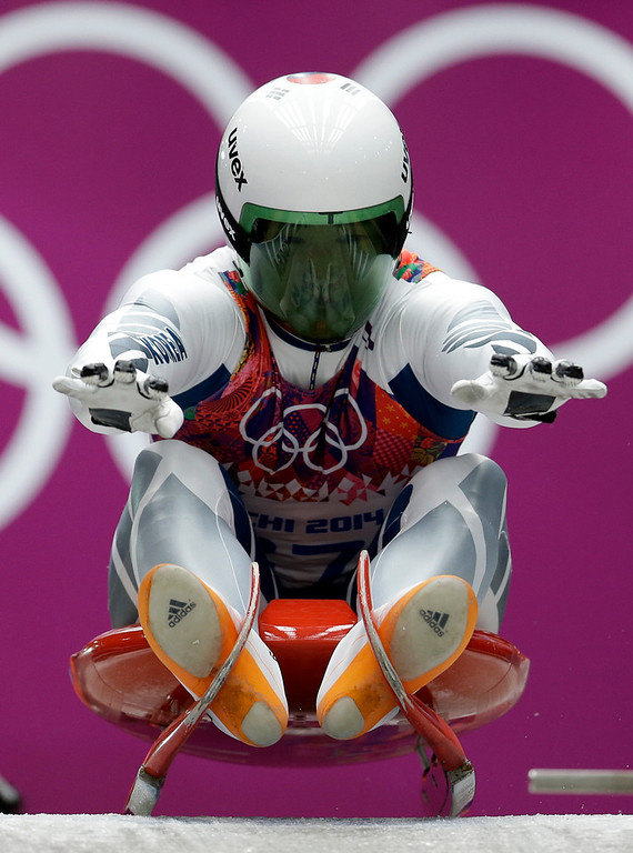 . Kim Donghyeon of South Korea starts his second run during the men\'s singles luge competition at the 2014 Winter Olympics, Saturday, Feb. 8, 2014, in Krasnaya Polyana, Russia. (AP Photo/Natacha Pisarenko)