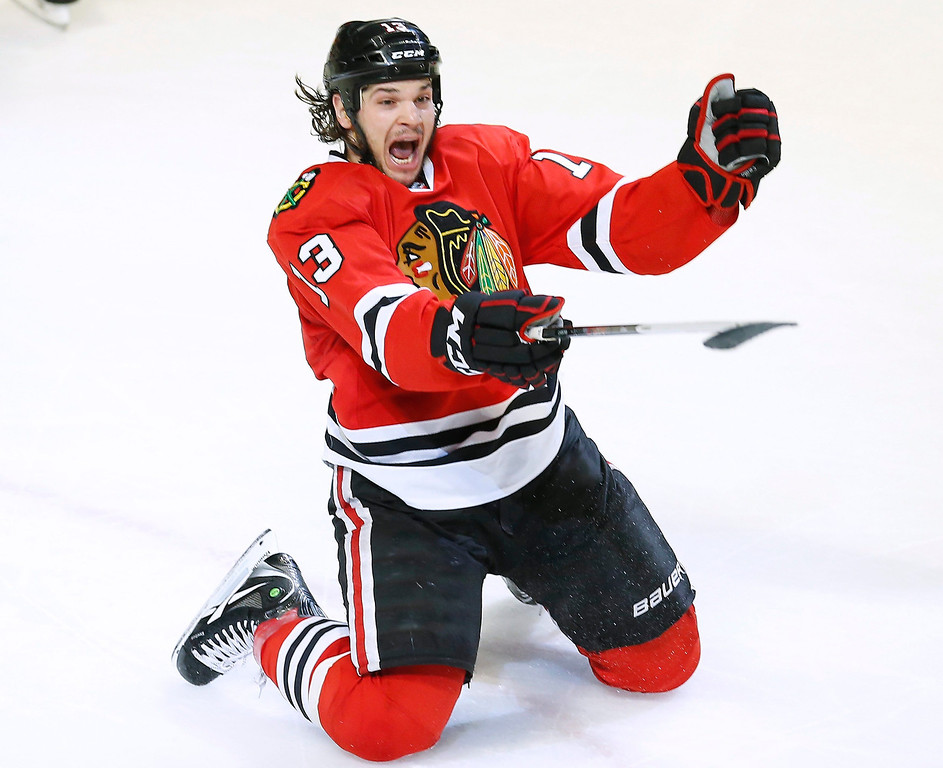 . Chicago Blackhawks\' Daniel Carcillo celebrates scoring the game winning goal against the Colorado Avalanche during the third period of their NHL hockey game in Chicago, Illinois, March 6, 2013. REUTERS/Jim Young