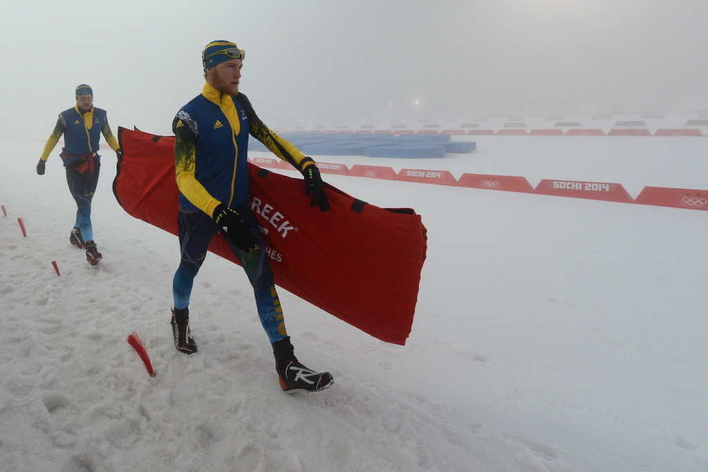 . Members of the Swedish team arrive at the track as the Men\'s Biathlon 15 km Mass Start is delayed due to a heavy fog at the Laura Cross-Country Ski and Biathlon Center during the Sochi Winter Olympics on February 16, 2014, in Rosa Khutor, near Sochi. The race was cancelled due to bad weather conditions.  KIRILL KUDRYAVTSEV/AFP/Getty Images