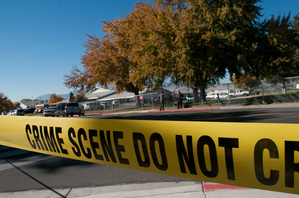 . Police tape secures the scene after a shooting at Sparks Middle School October 21, 2013 in Sparks, Nevada. A staff member was killed and two students were injured after a student opened fire at the Nevada middle school. The suspected gunman was also killed. (Photo by David Calvert/Getty Images)