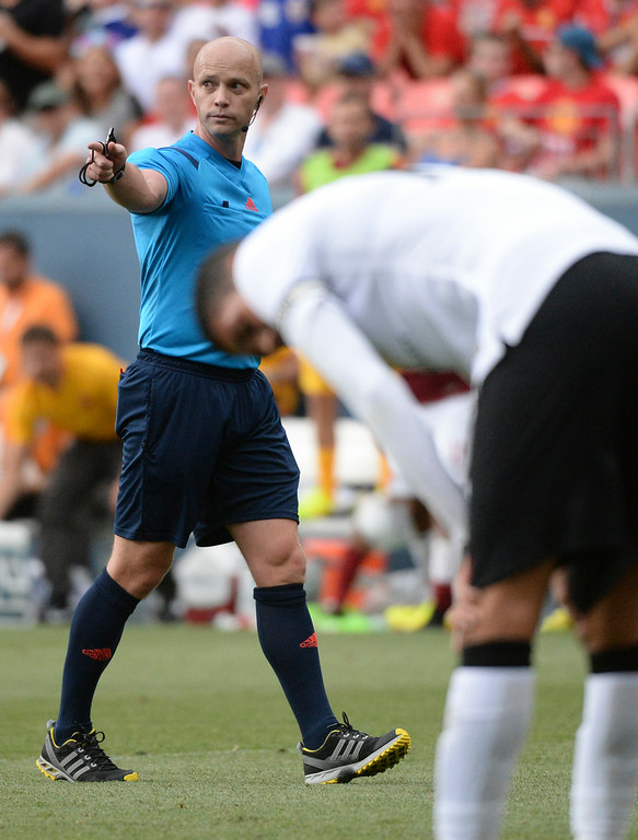 . Referee Allen Chapman called a hand ball on Manchester United in the second half. Manchester United defeated AS Roma 3-2 in an exhibition soccer game at Sports Authority Field in Denver Saturday afternoon, July 27, 2014. Photo by Karl Gehring/The Denver Post