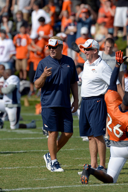 . Denver Broncos head coach John Fox talks with defensive coordinator Jack Del Rio during training camp August 6, 2013 at Dove Valley. (Photo By John Leyba/The Denver Post)