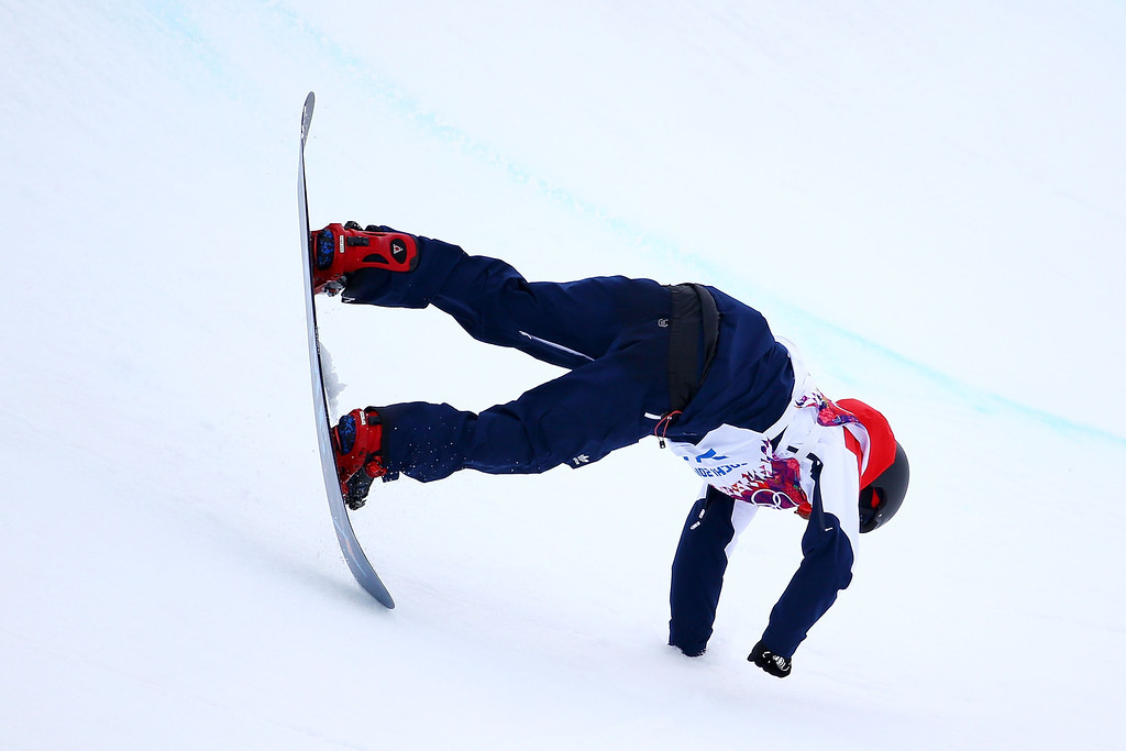 . Dominic Harington of Great Britain competes in the Snowboard Men\'s Halfpipe Qualification Heats on day four of the Sochi 2014 Winter Olympics at Rosa Khutor Extreme Park on February 11, 2014 in Sochi, Russia.  (Photo by Al Bello/Getty Images)