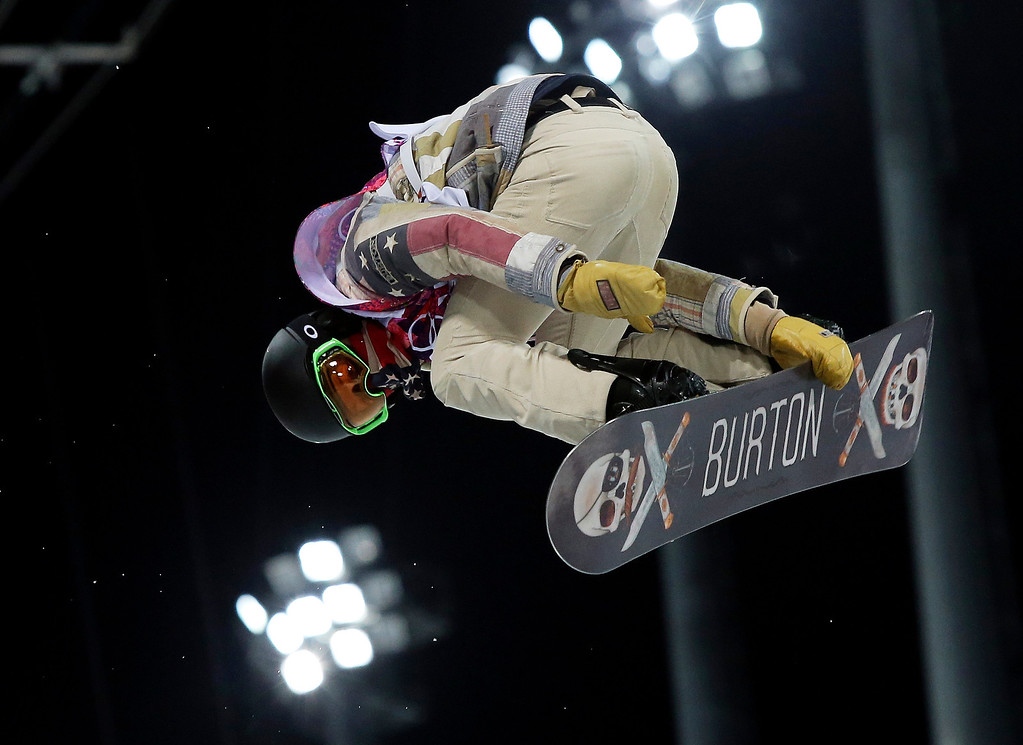 . Shaun White of the United States gets air during a snowboard half pipe training session at the Rosa Khutor Extreme Park at the 2014 Winter Olympics, Monday, Feb. 10, 2014, in Krasnaya Polyana, Russia.  (AP Photo/Sergei Grits)