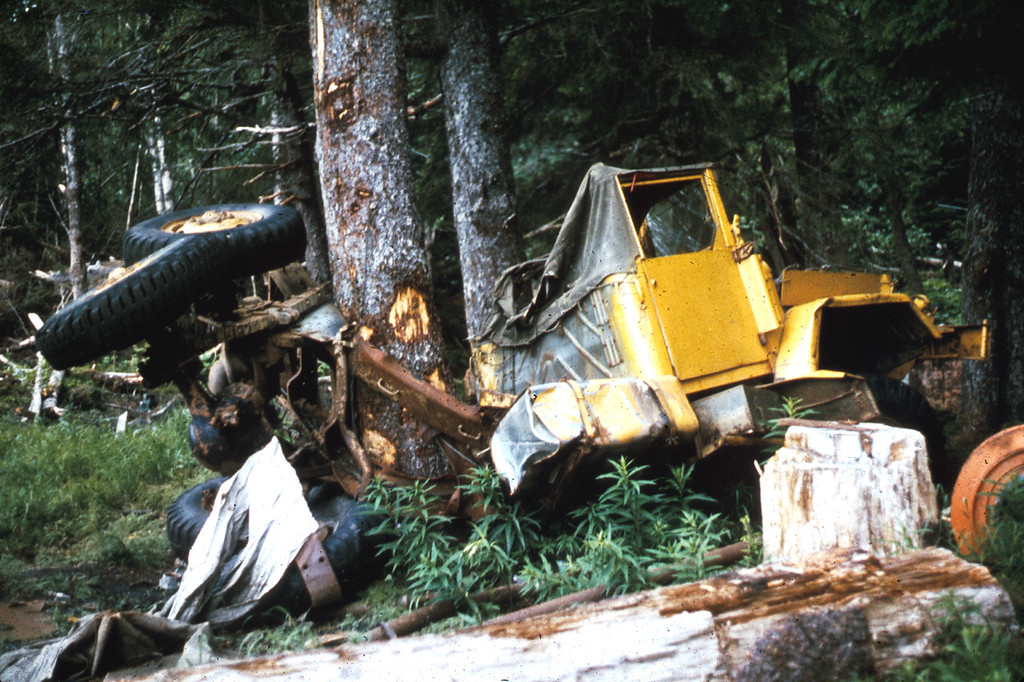 . Alaska Earthquake March 27, 1964. This truck at Lowell Point, 2 miles from Seward, was bent around a tree by the surge waves generated by the underwater landslides along the Seward waterfront. The truck was about 32 feet above water level at the time of the earthquake. U.S. Geological Survey photo