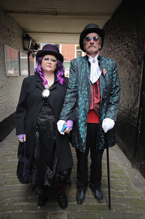 . WHITBY, ENGLAND - NOVEMBER 02: Jeanie and Mel Marton from Bridlington visit the Goth weekend on November 2, 2013 in Whitby, England. The Whitby Gothic Weekend that takes place in the Yorkshire seaside town twice yearly in Spring and Autumn started in 1994 and sees thousands of extravagantly dressed followers of Victoriana, Steampunk, Cybergoth and Romanticism visit to take part in celebrating Gothic culture.  (Photo by Ian Forsyth/Getty Images)