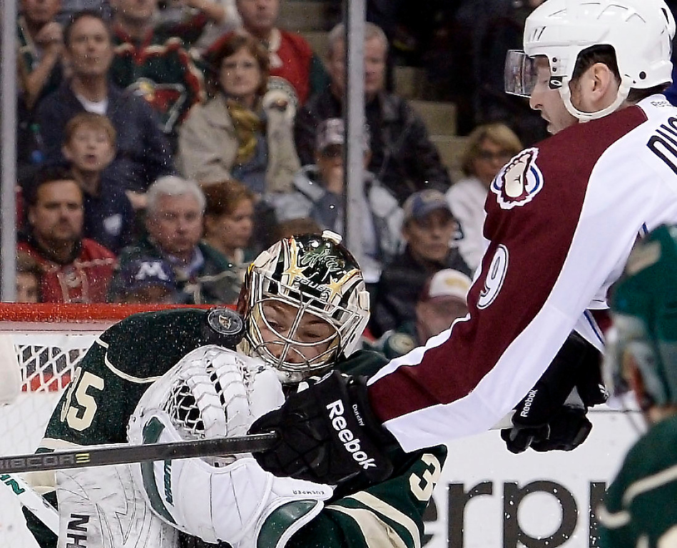 . Minnesota Wild goalie Darcy Kuemper (35) makes a save as Colorado Avalanche center Matt Duchene (9) tries to get his stick on the puck during the second period  April 28, 2014 in Game 6 of the Stanley Cup Playoffs at Xcel Energy Center.  (Photo by John Leyba/The Denver Post)