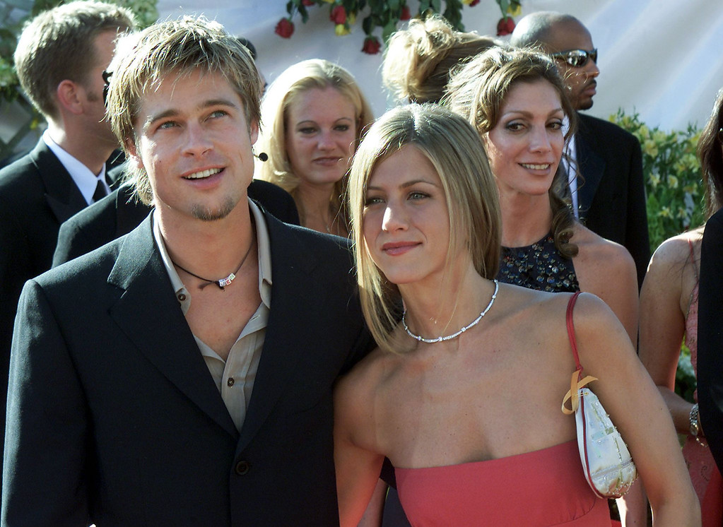 ". Actress Jennifer Aniston nominated for ""Supporting Actress, Comedy Series\"" for her role in the comedy \""Friends\"" poses with her husband Brad Pitt during the arrivals to the  52nd Annual Primetime Emmy Awards at the Shrine Auditorium in Los Angeles 10 September, 2000.   Scott Nelson/AFP/Getty Images"