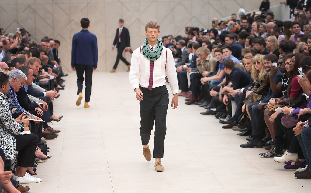 . Models wear creations by Burberry during London Men\'s spring summer fashion collections 2014, in London, Tuesday, June 18, 2013. (Photo by Joel Ryan/Invision/AP)