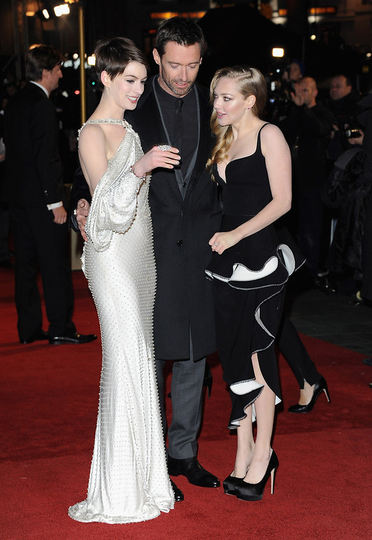 ". Actors Anne Hathaway, Hugh Jackman and Amanda Seyfriend attend the ""Les Miserables\"" World Premiere at the Odeon Leicester Square on December 5, 2012 in London, England.  (Photo by Stuart Wilson/Getty Images)"