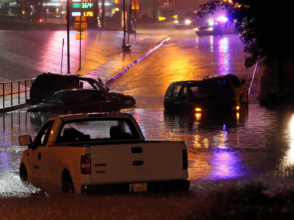 . Vehicles trapped by flash flooding sit underneath I-235 at NW 23rd in Oklahoma City, Friday, May 31, 2013. Severe thunderstorms brought tornadoes, high winds, heavy rain and hail to central Oklahoma on Friday. (AP Photo/The Oklahoman, Nate Billings)