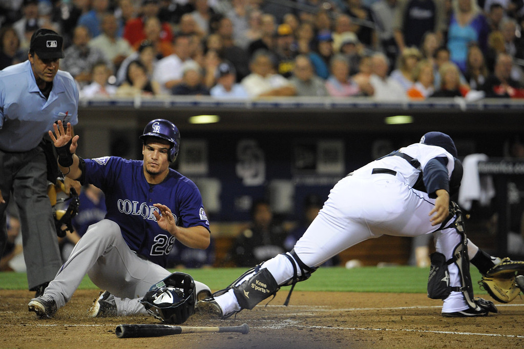 . Nolan Arenado #28 of the Colorado Rockies scores ahead of the tag of Rene Rivera #44 of the San Diego Padres during the sixth inning of a baseball game at Petco Park on July 8, 2013 in San Diego, California.  (Photo by Denis Poroy/Getty Images)