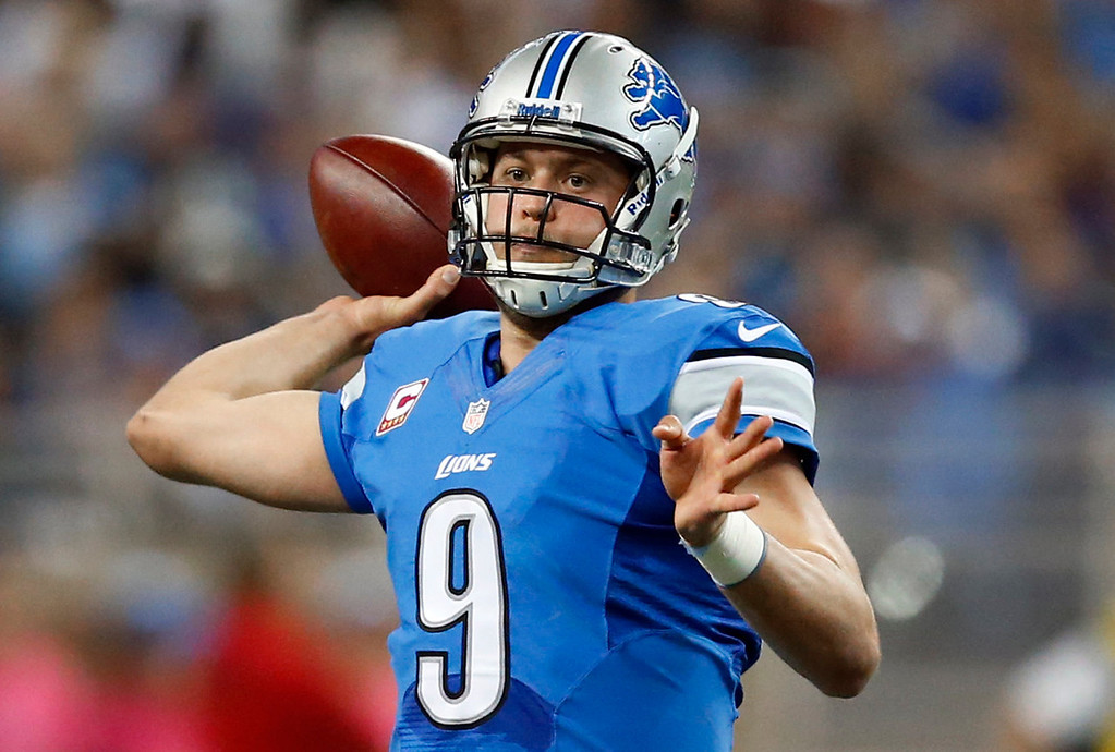 . Detroit Lions quarterback Matthew Stafford (9) throws in the first quarter of an NFL football game against the Cincinnati Bengals Sunday, Oct. 20, 2013, in Detroit. (AP Photo/Rick Osentoski)