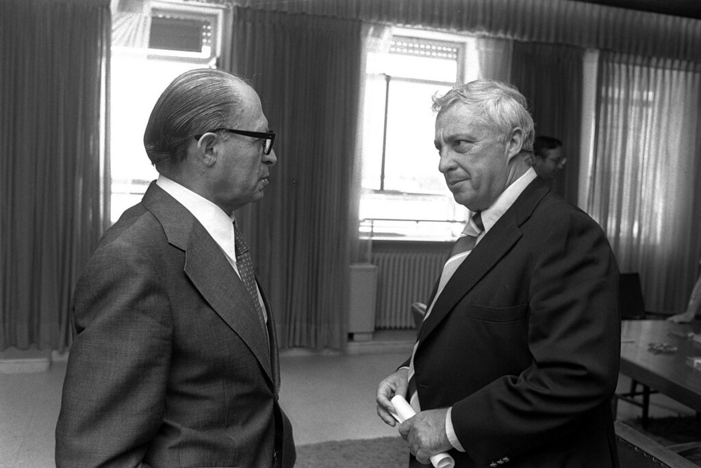 . In this handout from the Israeli Governmental Press Office, Agriculture Minister Ariel Sharon (R) meets with Prime Minister Menahem Begin in the prime ministry August 9, 1977 in Jerusalem. (Photo by Yaakov Saar/GPO via Getty Images)