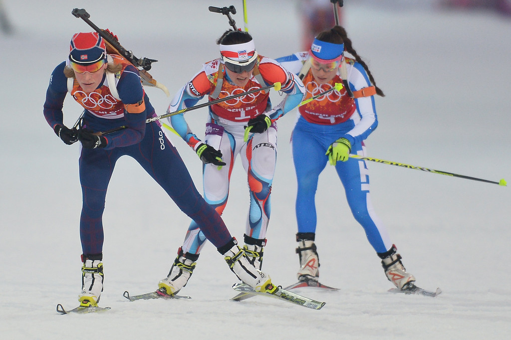 . Gold medalist Norway\'s Tora Berger (L), Silver medalist Czech Republic\'s Veronika Vitkova and bronze medalist Italy\'s Dorothea Wierer compete  in the compete in the Biathlon mixed 2x6 km + 2x7,5 km Relay at the Laura Cross-Country Ski and Biathlon Center during the Sochi Winter Olympics on February 19, 2014 in Rosa Khutor near Sochi. AFP PHOTO / ALBERTO PIZZOLI/AFP/Getty Images