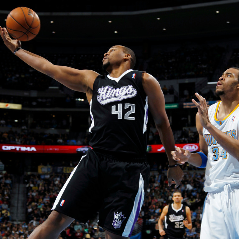 . Sacramento Kings forward Chuck Hayes, left, pulls in a rebound in front of Denver Nuggets forward JaVale McGee in the first quarter of an NBA basketball game in Denver on Saturday, Jan. 26, 2013. (AP Photo/David Zalubowski)