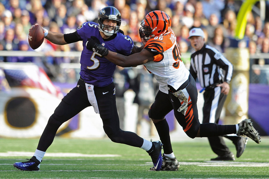 . Baltimore Ravens quarterback Joe Flacco is sacked by Cincinnati Bengals defensive end Carlos Dunlap during the first half of a NFL football game in Baltimore, Sunday, Nov. 10, 2013. (AP Photo/Gail Burton)
