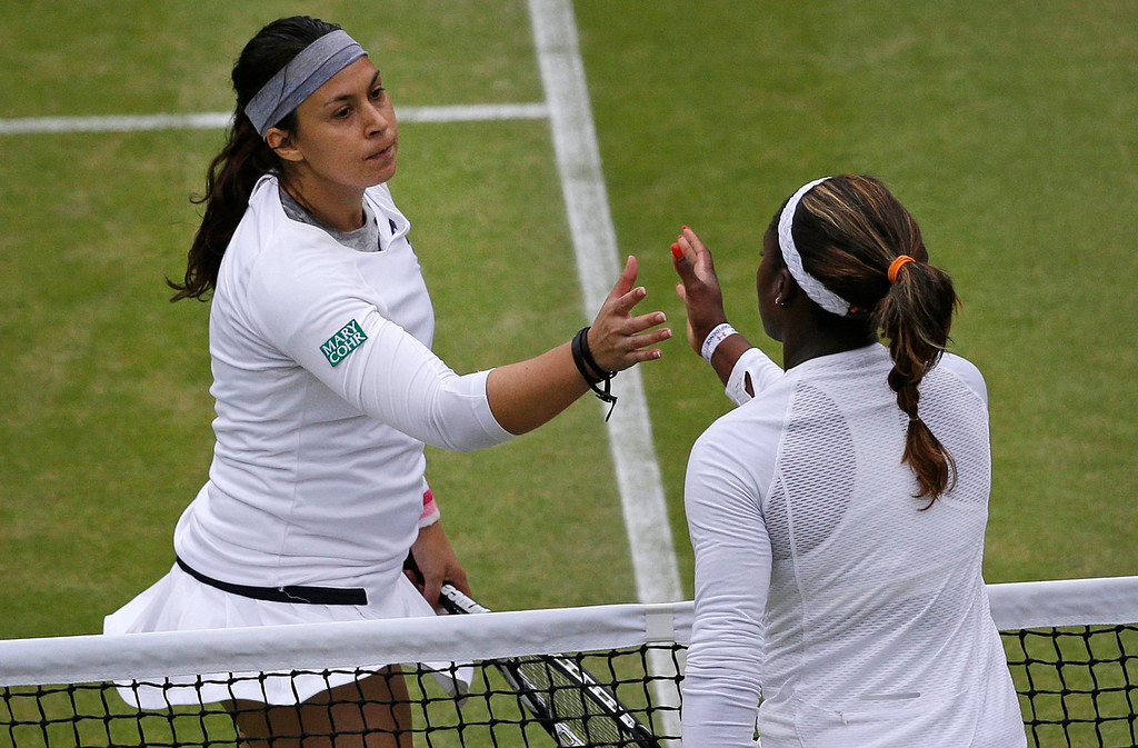 . Marion Bartoli of France, left, shakes hands with Sloane Stephens of the United States after defeating her in a Women\'s singles quarterfinal match at the All England Lawn Tennis Championships in Wimbledon, London, Tuesday, July 2, 2013. (AP Photo/Anja Niedringhaus)