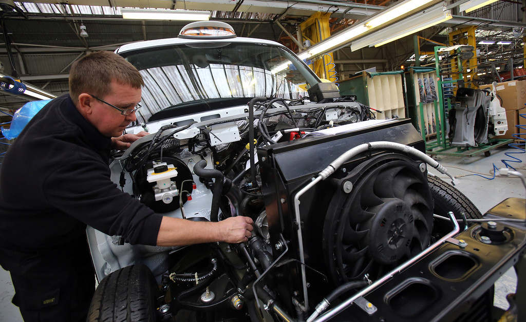 . Steve Pearce works on a TX4 (Euro 5) London Taxi on the assembly line inside the factory of the London Taxi Company on September 11, 2013 in Coventry, England.   (Photo by Matt Cardy/Getty Images)