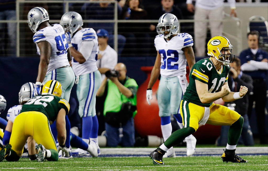 . Green Bay Packers quarterback Matt Flynn (10) celebrates the game-winning touchdown against the Dallas Cowboys during the second half of an NFL football game, Sunday, Dec. 15, 2013, in Arlington, Texas. Green Bay won 37-36. (AP Photo/Tim Sharp)