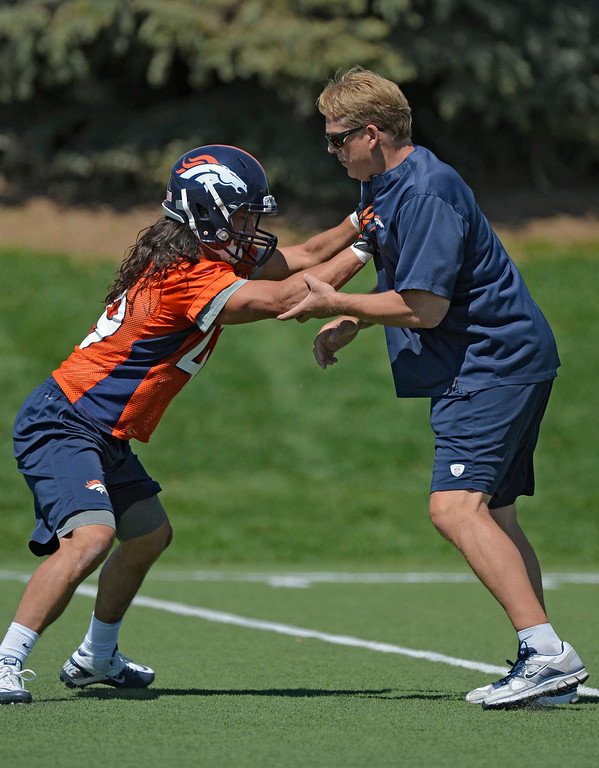 . Damien Holmes (49) of the Denver Broncos works with Jack Del Rio, defensive coordinator of the Denver Broncos, during the last day of rookie mini camp on May 12, 20313 at Dover Valley.   (Photo By John Leyba/The Denver Post)