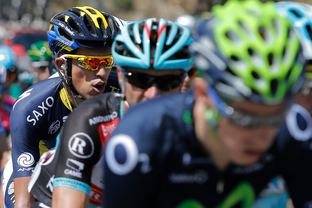 . Spain\'s Alberto Contador, left, rides in the pack during the second stage of the Tour de France cycling race over 156 kilometers (97.5 miles) with start in Bastia and finish in Ajaccio, Corsica island, France, Sunday June 30, 2013. (AP Photo/Laurent Cipriani)