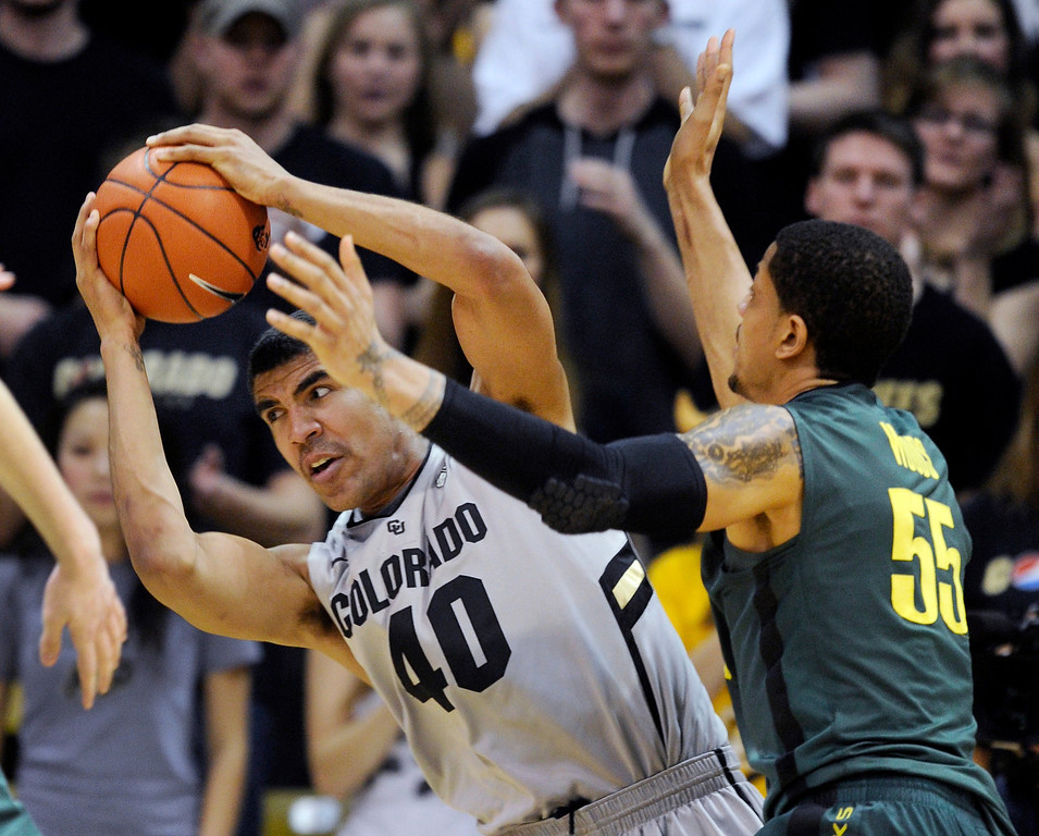 . BOULDER, CO. - MARCH 7: Colorado center Josh Scott secured the ball after rejecting an attempt from Oregon\'s Tony Woods in the second half. The University of Colorado men\'s basketball team defeated Oregon 76-53 Thursday night, March 7, 2013 at the CU Events Center in Boulder. (Photo By Karl Gehring/The Denver Post)