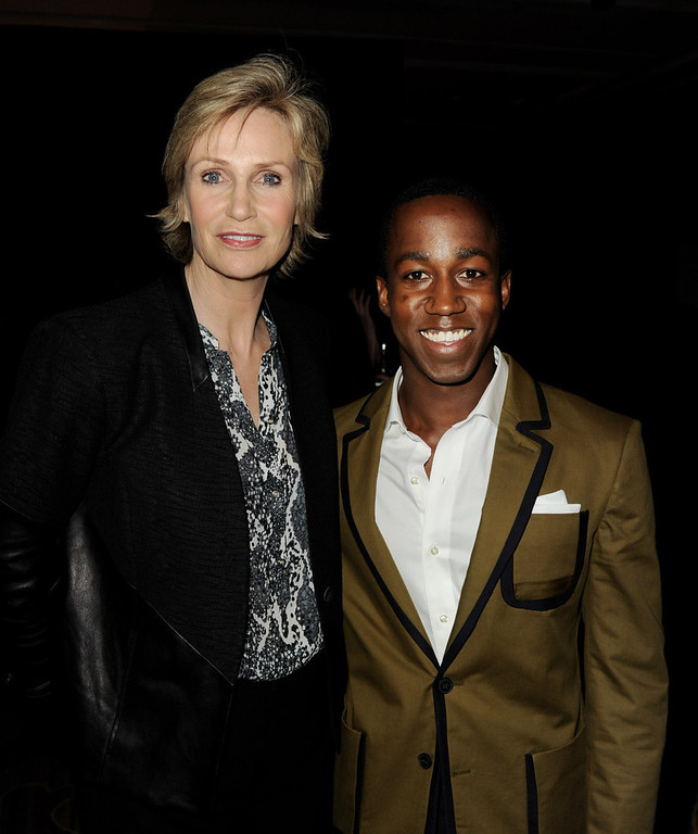 """. Actress Jane Lynch (L) and honoree Lenworth Poyser pose at \""""An Evening\"""" benifiting The L.A. Gay & Lesbian Center at the Beverly Wilshire Hotel on March 21, 2013 in Beverly Hills, California.  (Photo by Kevin Winter/Getty Images)"""