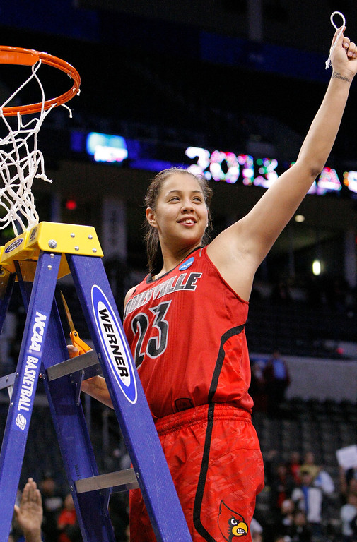 . Louisville\'s Shoni Schimmel cuts down a piece of the net after her team defeated Tennessee during their regional final game in the women\'s NCAA college basketball tournament in Oklahoma City, Tuesday, April 2, 2013. (AP Photo/Alonzo Adams)