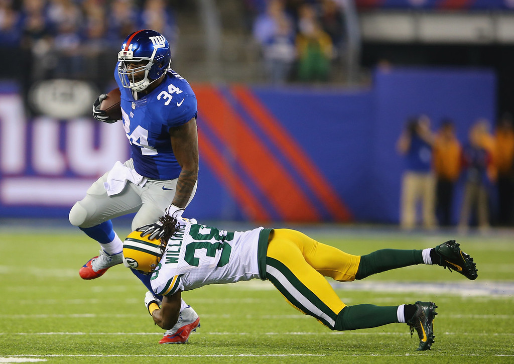 . Brandon Jacobs #34 of the New York Giants runs against  Tramon Williams #38 of the Green Bay Packers during their game at MetLife Stadium on November 17, 2013 in East Rutherford, New Jersey.  (Photo by Al Bello/Getty Images)