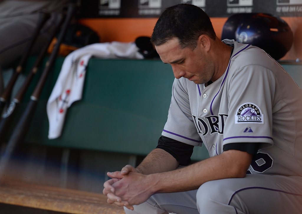 . Pitcher Jeff Francis #26 of the Colorado Rockies sits in the dugout after he was taken out of the game against the San Francisco Giants in the bottom of the second inning at AT&T Park on April 10, 2013 in San Francisco, California. The Giants scored seven runs in the first two inning of the game. (Photo by Thearon W. Henderson/Getty Images)