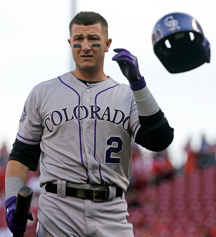 . Colorado Rockies\' Troy Tulowitzki tosses his helmet after striking out against Cincinnati Reds starting pitcher Homer Bailey in the first inning of a baseball game, Tuesday, June 4, 2013, in Cincinnati. (AP Photo/Al Behrman)