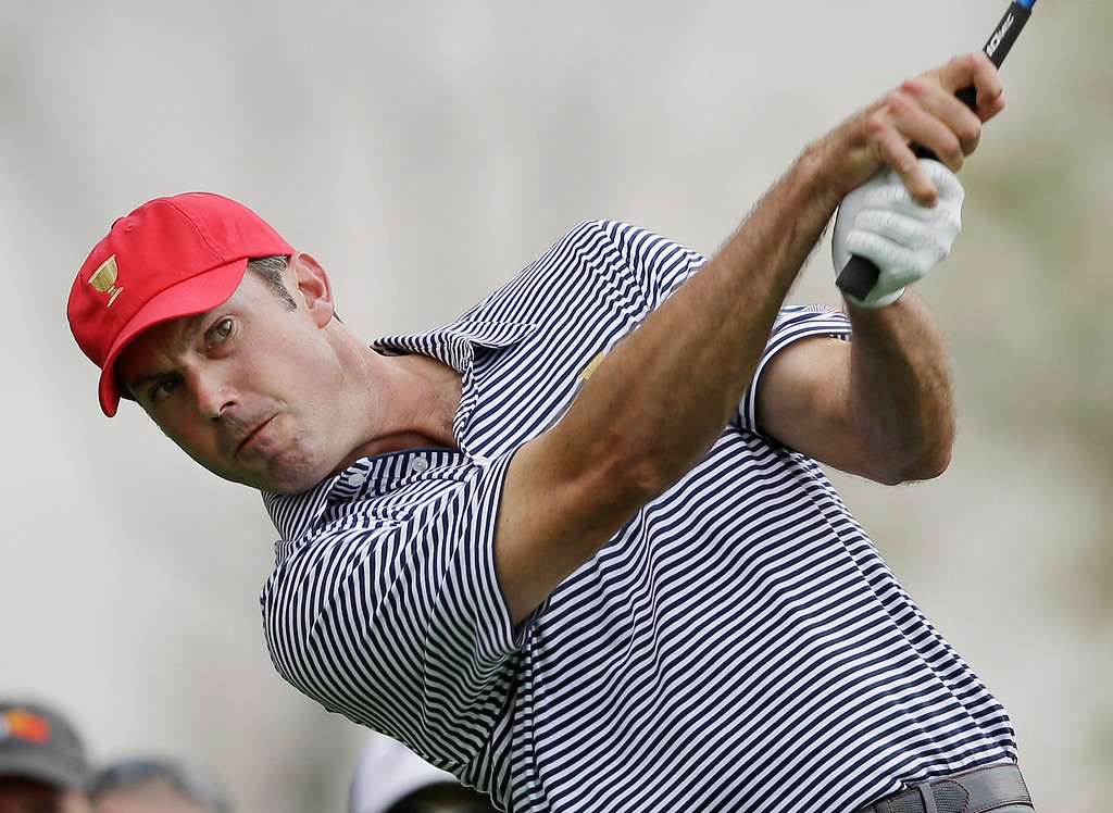 . United States team player Matt Kuchar tees off the third hole during a foursome match at the Presidents Cup golf tournament at Muirfield Village Golf Club, Friday, Oct. 4, 2013, in Dublin, Ohio. (AP Photo/Darron Cummings)